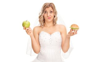 bigstock-young-bride-holding-an-apple-i-112518509-300x200